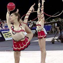 Twins Celebrate Rhythmic Bronze with Oriental Dances