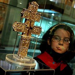 Sofia Displays Crucifix-Piece Cross, Gold Treasure