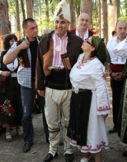 Bulgarian Interior Minister Honors Folk Fest in Traditional Attire: Bulgaria's Top Cop Honors Folk Fest in Traditional Attire