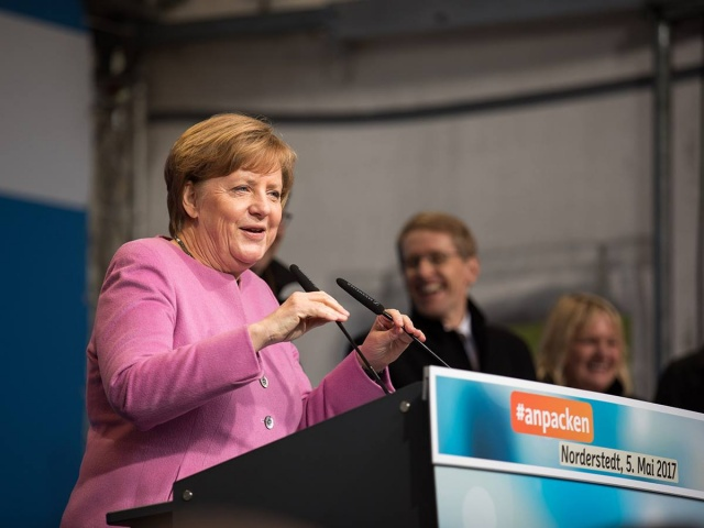 Bulgaria: Merkel, Facing Long Night, says German Coalition Talks Can Work