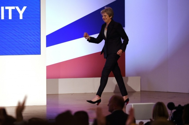 Theresa May grooves to ABBA's 'Dancing Queen' at Tory Conference