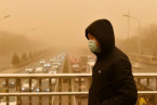 Powerful Sandstorm coming from Mongolia Wraps Beijing in Apocalyptic-Looking Yellow Smog