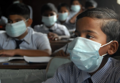 In pictures: Indian school children sit in their class room ...