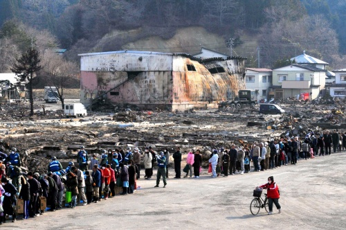 In pictures: Japanese tsunami victims, numbering 300, wait in line ...