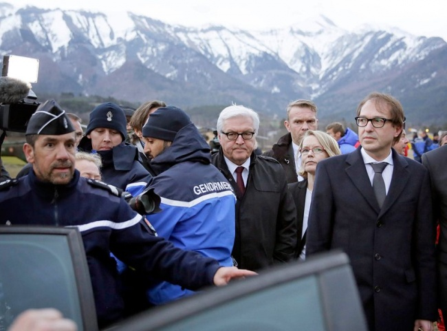 German Foreign Affairs Minister Frank-Walter Steinmeier (C) and German Transport Minister Alexander Dobrindt (R) visit the situation centre, close to the crash site of the Germanwings aircraft, near Seyne Les Alpes, France, March 24, 2015.